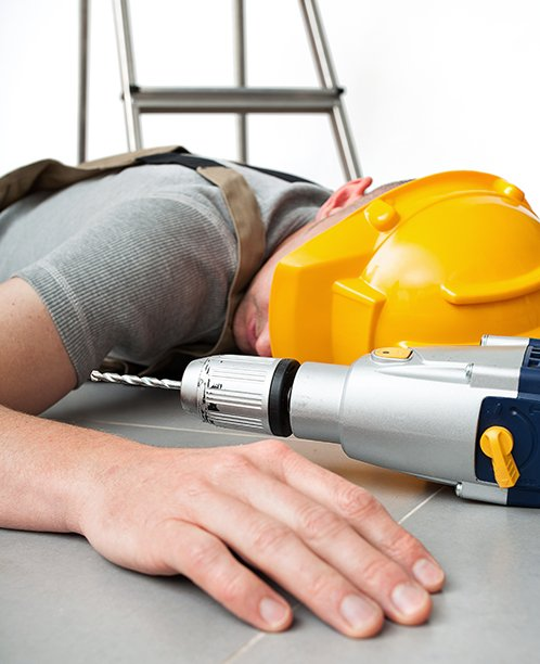 Construction Worker on the Ground after a Fall from a Ladder - Our Workers' Compensation Attorneys Can Help